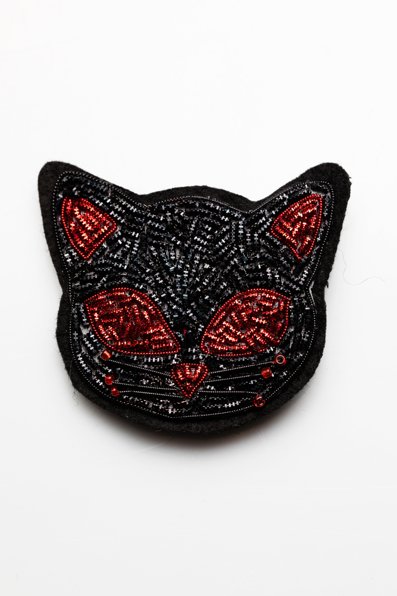chat broderie or